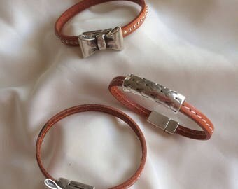 Featuring 5 mm burnt orange leather bracelets
