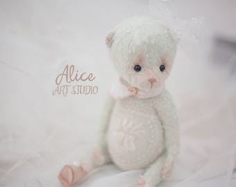 Teddy bear embroidered with lace.