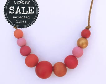 reds, pinks and gold hand painted wooden bead necklace