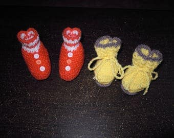 pair of knitted booties for newborn babies
