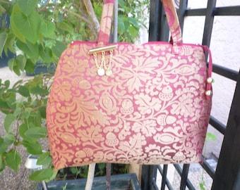 Like rust and bronze Brocade satin handbag