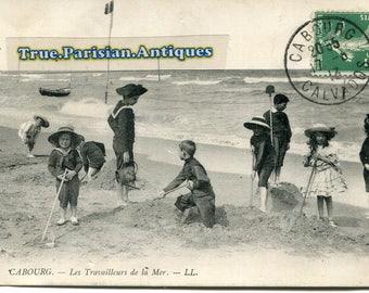 1900 children in marine costumes at the beach