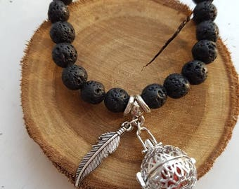 Diffuser bracelet for essential oils.  Lava beads and silver detail.  Locket & feather charm. FREE SHIPPING AU