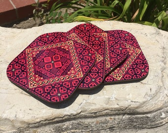 Palestinian embroidered coasters set , holder included .