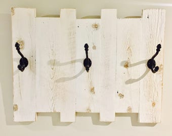 White rustic reclaimed wood coat rack with 3 antique vintage cast iron hooks