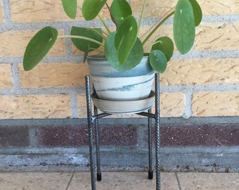 Colored clay Flowerpot on reinforcing steel frame legs