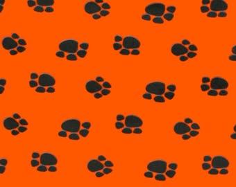 Orange Paw Print Fleece Fabric by the yard