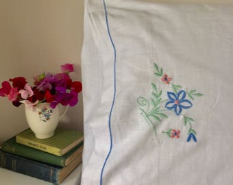 One standard size pillowcase. Vintage. White with embroidered flowers. 1940's