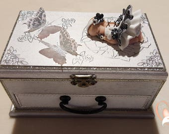 Gray and white baby music box girl - the heart of the arts
