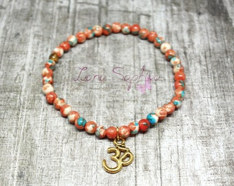 Pearl bracelet orange/green/white with Golden OM pendant