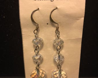 """Three sparkling Swarovski Crystals dangle on Sterling ear wires. Earrings measure 2""""long x 1/4""""wide."""