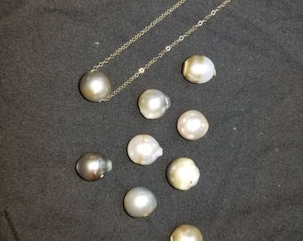 """11mm tahitian pearl floating on 18"""" gold filled chain."""