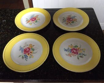 A Set Of Four Vintage English New Chelsea Yellow Rimmed Floral Decorated Plates