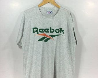 On sale 30% Vintage Reebok Big Logo SpellOut Hip Hop Streetwear Style Rare 90s T Shirt