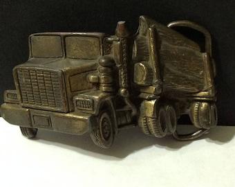 Vintage brass belt buckle, cut out, logging truck, MBC.