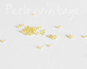Small gold seed beads transparent 5 grams