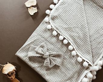 Textured Pom Swaddle Blanket