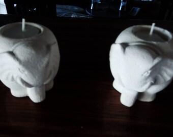 CANDLE HOLDERS ELEPHANT with tea lights.