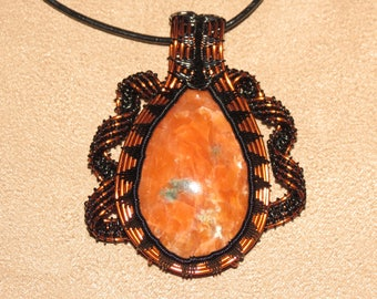 327 Ribbon weaved orange and black spike Canadian orange calcite