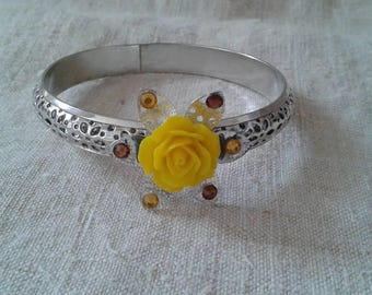 engraved silver bracelet and yellow flower