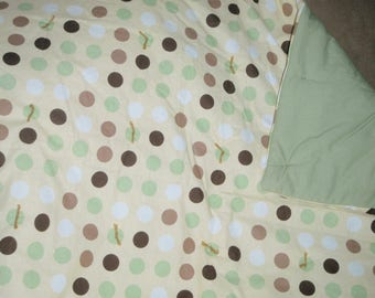 Green and brown polka dot quilt