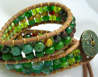 Double wrap bracelet in greens and browns, bird and moon tassels