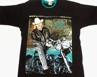 Alan Jackson riding a Harley with a mustache and a mullet...need i say more? Hanes Heavyweight Black 100% cotton Size: LARGE