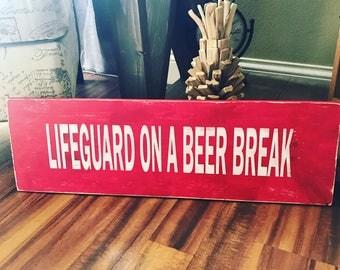 Lifeguard on a beer break outdoor wood sign