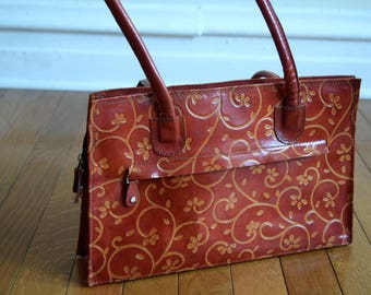 Vintage Leather Handbag With Floral Imprint