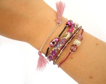 Silver cuff bracelet is purple/pink
