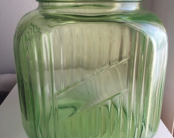 Vintage green glass storage jar with metal lid