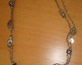Necklace with dice and cuffs