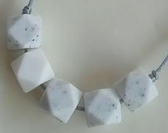 Lovely white granite hexagon silicone beads with white hexagon feature bead.