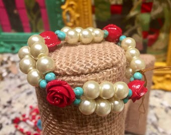 Red rose with ivory pearl tone stretch bracelet