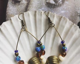 Eclectic dangle hoop earrings.