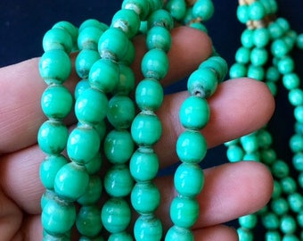 GREEN GLASS BEADS... Boho Chic, stunning Vintage necklace, 6 strands of glass beads with coin closure, evening necklace, daytime necklace