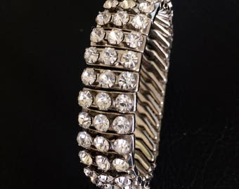 Sparkly clear rhinestone and silver tone signed Empire Made expandable bracelet