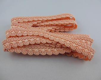 Light salmon color upholstery braid