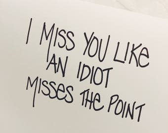 I miss you like an idiot misses the point- Blank Greeting Card