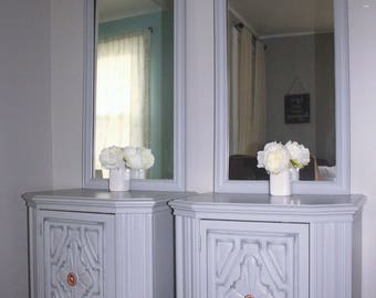 two night stands with matching mirrors
