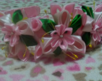 Handmade pink flower ribbon headband with floral design.