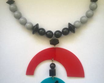 LUCITE NECKLACE, lucite pendant on 17 inch choker with black,gray, red beads