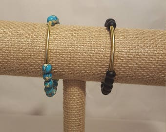 Stone bead bracelet with gold tube bar