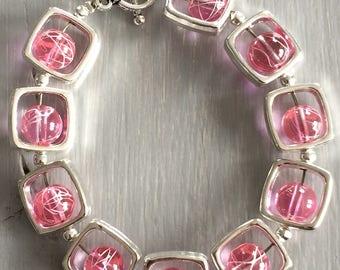 Fancy pink and silver Bead Bracelet