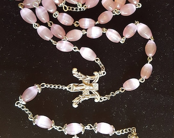 Hand-crafted rosary with ornate metal crucifix and Marian center, 8mm pink oval cat's-eyes glass beads, metal-capped Our Father beads.