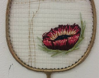 Embroidered badminton racket
