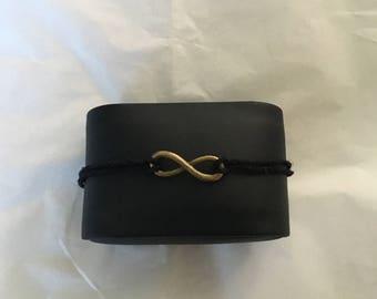 Adjustable black hemp cord bracelet with bronze infinity charm