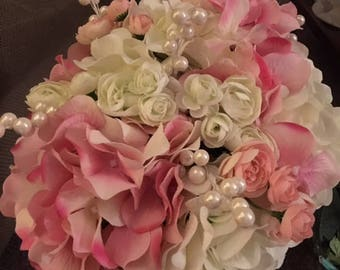 White and pink bridal bouquet with pearl accents
