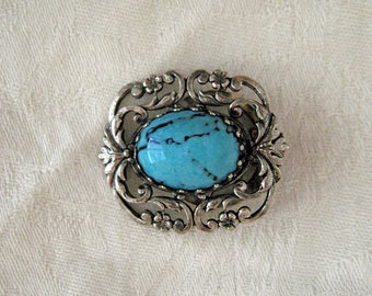 Vintage scarf brooch with faux turquoise cabochon and silver filigree setting