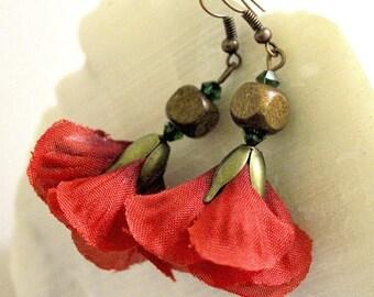 Floral red earrings.